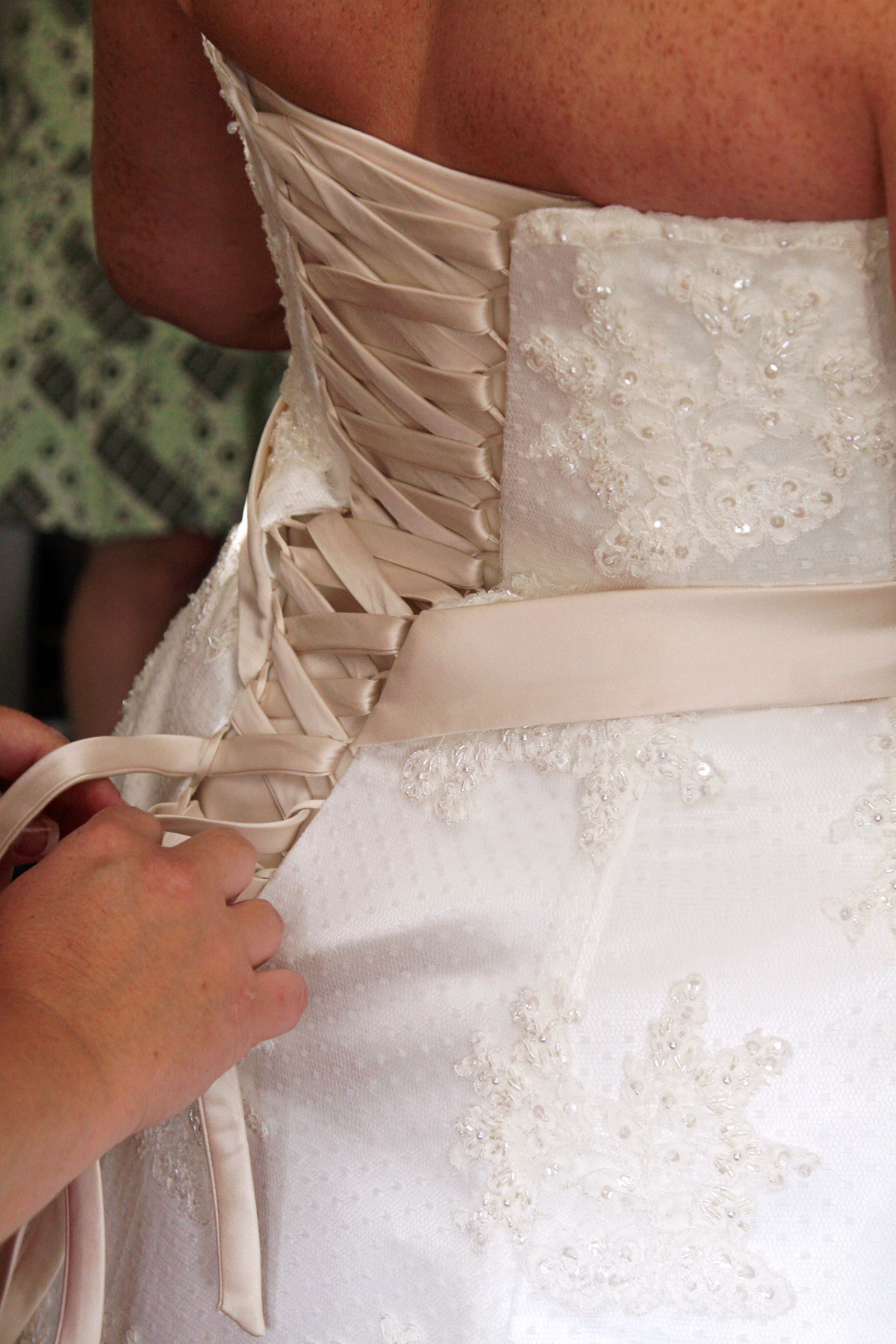 Tying of the wedding gown