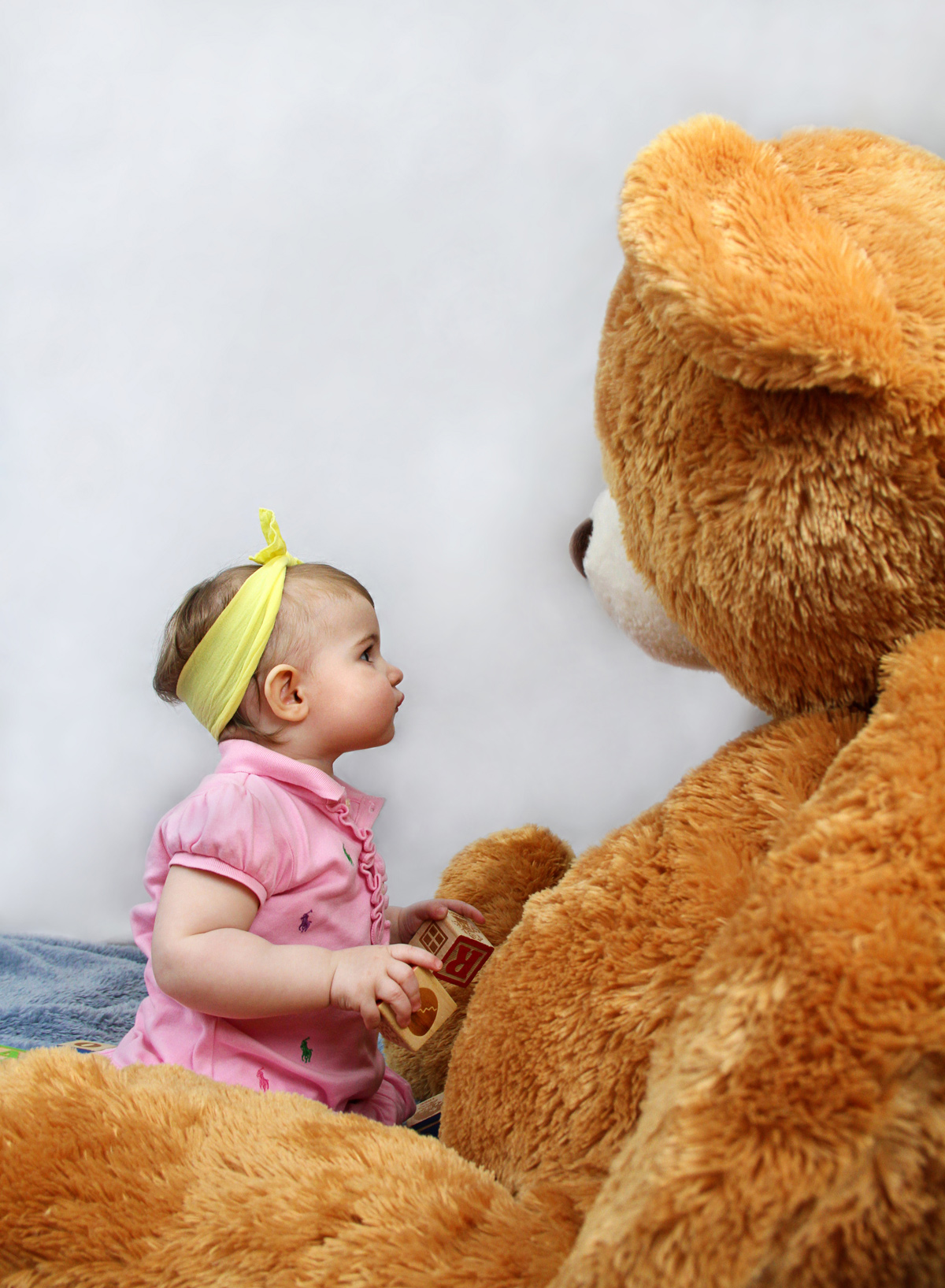 Baby girl and big teddy bear